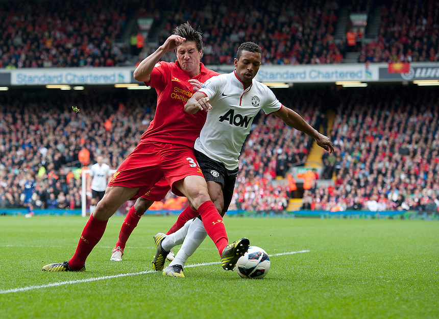 Manchester United's Nani is sent flying with this challenge from Liverpool's Martin Kelly ..Football - Barclays Premiership - Liverpool v Manchester United - Sunday 23rd September 2012 - Anfield - Liverpool..