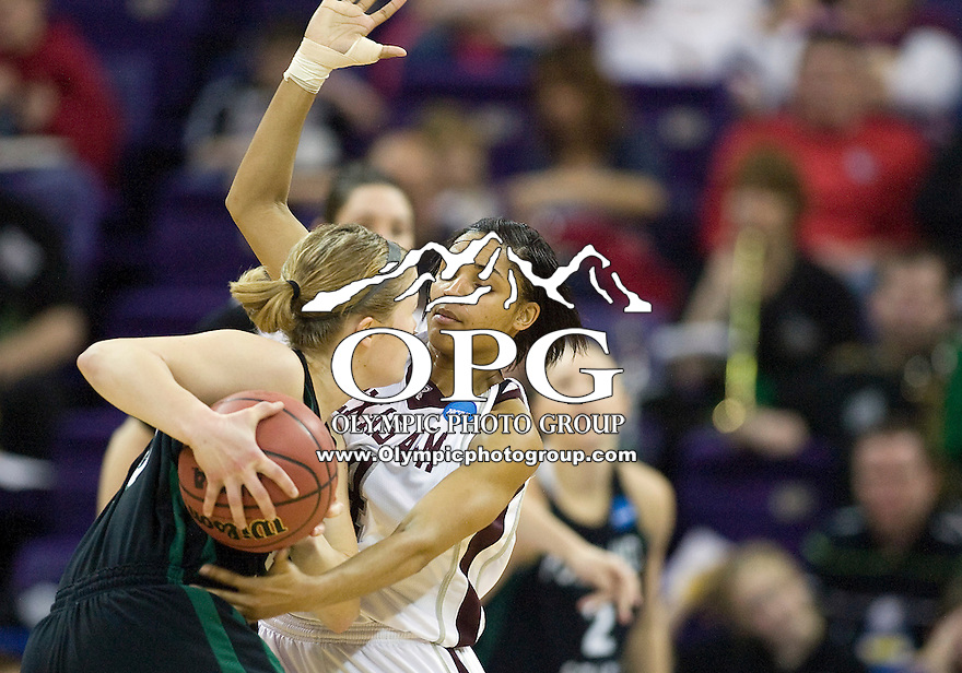 20 March 2010:  Texas A&M guard #4 Sydney Carter adds pressure on defense against Portland State. Texas A&M won 84-53 over Portland State in the first round of the NCAA Women's Basketball Tournament held at the Bank of America Arena in Seattle, WA.