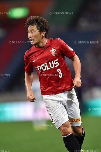 Tomoya Ugajin (Reds),<br /> AUGUST 16, 2014 - Football / Soccer :<br /> 2014 J.League Division 1 match between Urawa Red Diamonds 1-0 Sanfrecce Hiroshima at Saitama Stadium 2002 in Saitama, Japan. (Photo by AFLO)