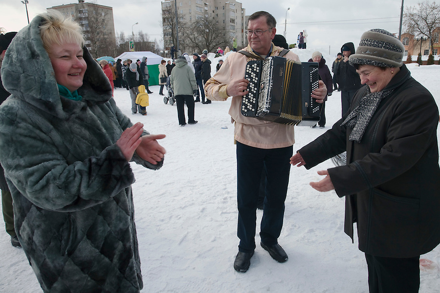 Istra, Russia, 06/03/2011..Women dancing as people celebrate Maslenitsa, also known as Butter Week or Pancake Week. Maslenitsa marks the beginning of the Russian Orthodox period of Lent, but is a traditional Russian Holiday marking the end of winter, and has its origins in pagan times.