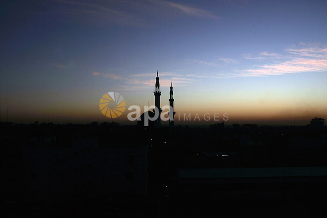 Minarets of a mosque are seen in the sky during the sunset in the Rafah town in southern Gaza Strip, on the border with Egypt on February 7, 2010. Photo by Abed Rahim Khatib