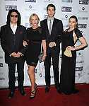 Gene Simmons and family at the Mending Kids Gala Honoring Gene Simmons and family, held at the Santa Monica Airport Hanger 8 on November 9, 2013