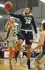 Donnetta Johnson #30 of Baldwin makes an acrobatic move inside the paint during the Class AA Long Island Championship against Commack at Suffolk County Community College Grant Campus in Brentwood on Thursday, March 8, 2018. Baldwin won by a score of 78-48.
