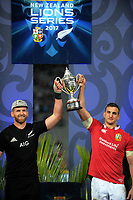 Team captains Kieran Read (left) and Sam Warburton share the series trophy after the 2017 DHL Lions Series rugby union 3rd test match between the NZ All Blacks and British & Irish Lions at Eden Park in Auckland, New Zealand on Saturday, 8 July 2017. Photo: Dave Lintott / lintottphoto.co.nz