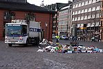 Cleaning up street rubbish, fish market, St Pauli Hamburg, Germany.
