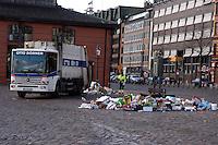 Cleaning up street rubbish, fish market, St Pauli Hamburg, Germany.