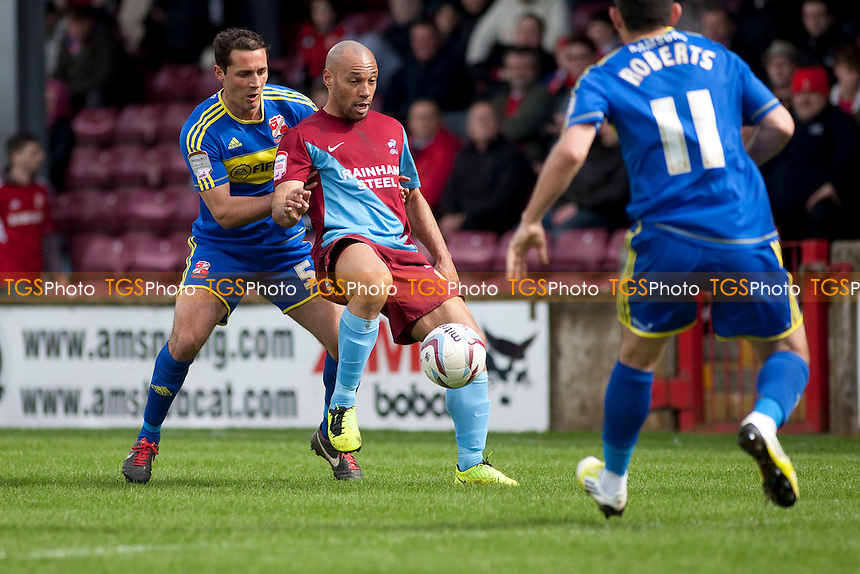 Karl Hawley (Scunthorpe Utd) close control. - Scunthorpe United vs Swindon Town - NPower League One Football at Glanford Park - 27/04/13 - MANDATORY CREDIT: Mark Hodsman/TGSPHOTO - Self billing applies where appropriate - 0845 094 6026 - contact@tgsphoto.co.uk - NO UNPAID USE.