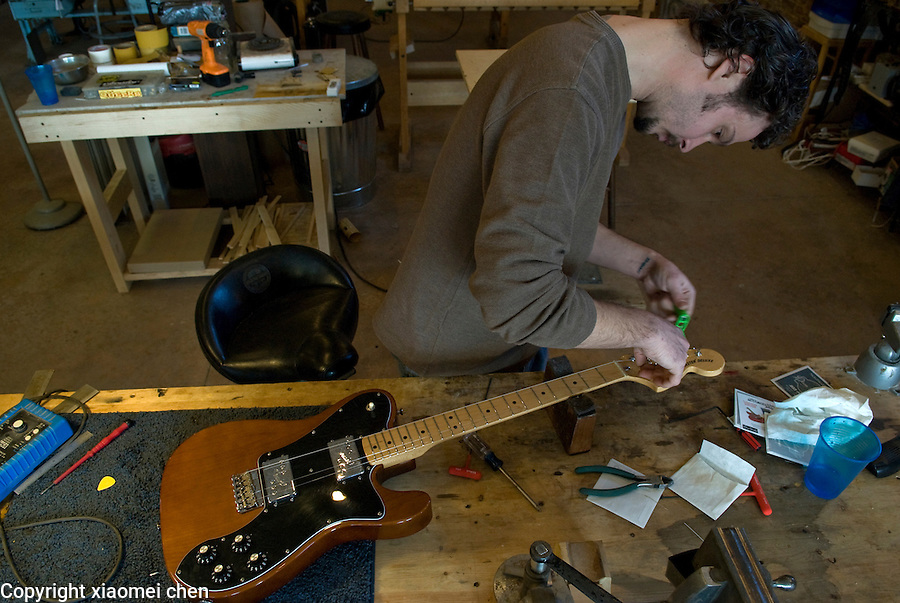 Gene Imbody of Athens, Ohio, repairs a guitar at United Lutherie on February 13, 2008.  Gene Imbody and his partner Eric Coleman co-run a guitar repair shop, United Lutherie in Jacksonville, Ohio. They began their business in Jacksonville in 2006. Besides repairing and remodeling guitars, they also make brand new guitars at customers' request..