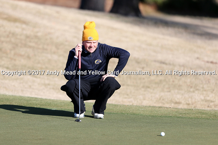 WILMINGTON, NC - MARCH 19: Kent State's Gisli Sveinbergsson (ISL) lines up a putt on the Ocean Course third hole. The first round of the 2017 Seahawk Intercollegiate Men's Golf Tournament was held on March 19, 2017, at the Country Club of Landover Nicklaus Course in Wilmington, NC.