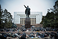 During Eid al-Adha, several thousand Muslims pray in front of the parliament building and a statue of Lenin.