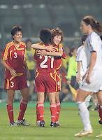 China celebrates. The FIFA Women's World Stars played an exhibition match against China at the Wuhan Sports Center Stadium as part of the Women's World Cup Draw on April 21, 2007.