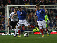 Ian Black  being closed down by Chris Mitchell as Lewis McLeod watches in the Rangers v Queen of the South Quarter Final match in the Ramsdens Cup played at Ibrox Stadium, Glasgow on 18.9.12.