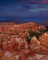 730750030v sunset light turns the silent city hoodoos a reddish gold during a clearing summer storm seen from sunset point in bryce canyon national park in south central utah