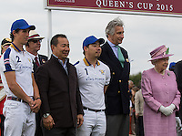 (l-r) Hugo Lewis (King Power Foxes), Vichai Srivaddhanaprabha (King Power CEO) Aiyawatt Srivaddhanaprabha (King Power Foxes) Arnaud M. Bamberger, Executive Chairman and Her Majesty the Queen during the Cartier Queens Cup Final match between King Power Foxes and Dubai Polo Team at the Guards Polo Club, Smith's Lawn, Windsor, England on 14 June 2015. Photo by Andy Rowland.