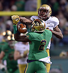 (Boston, MA, 11/21/15) Boston College's Gabriel McClary (14) breaks up a pass intended for Notre Dame's Chris Brown during the second quarter as Notre Dame hosts Boston College at Fenway Park in Boston on Saturday, November 21, 2015. Photo by Christopher Evans