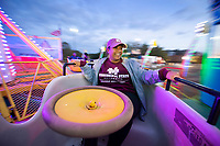 MSU Student Association Director of Programming Ella Stevenson, a junior business administration major from Huntsville, Alabama, enjoys a ride at Friday's [Nov. 9] campus carnival. Originally scheduled as a Homecoming carnival but rescheduled due to rain, the free event included rides, waffles on a stick, cotton candy and hot chocolate.<br />  (photo by Megan Bean / &copy; Mississippi State University)