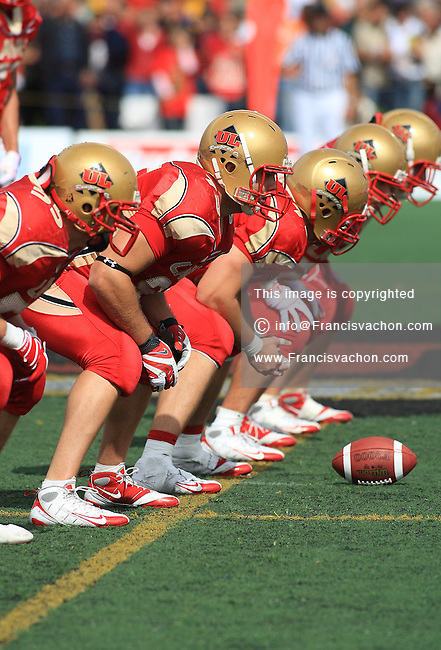 Rouge et Or de l'universite Laval's offensive line gets ready for a play  in CIS football action against the Carabins de l'Universite de Montreal at the universite Laval stadium in Quebec City, September 7, 2008. Laval won 17-6 before a crowd of 15,275.