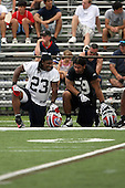 July 26th 2008:  Running back Marshawn Lynch (23) and Linebacker Kawika Mitchell (59) of the Buffalo Bills take a rest during the second day of training camp at St. John Fisher College in Rochester, NY.  Photo Copyright Mike Janes Photography 2008.