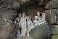 Monument to Julius Zeyer, 1841-1901, Czech writer, playwright and Romantic poet, 1931, by Josef Mauder, in Chotkovy Sady or the Chotek Gardens, the first public park in Prague, opened 1833, Prague, Czech Republic. The grotto-like monument features life-size characters from Zeyer's works carved in white marble, emerging from the rocks. The historic centre of Prague was declared a UNESCO World Heritage Site in 1992. Picture by Manuel Cohen