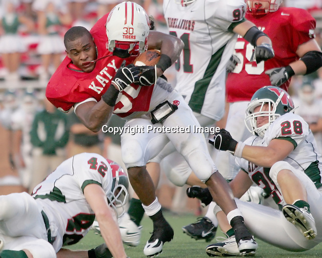 Katy High School star running back Aundre Dean loses his helmet but gains a first down in the 48-7 Katy win over the Woodlands High School September 8, 2007 in Katy, Texas