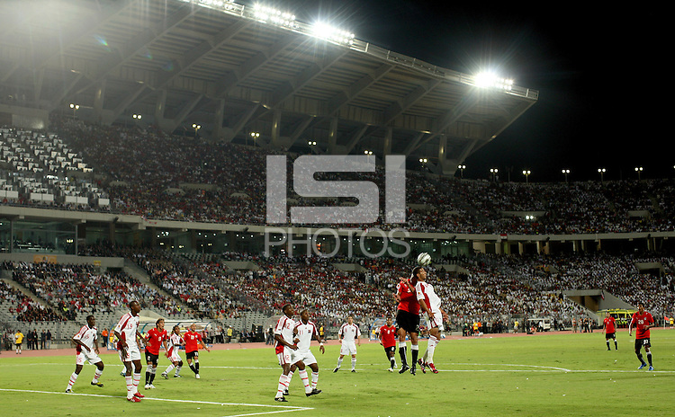Egypt's Salah Soliman and Trinidad & Tobago's Khaleem Hyland compete for a header during the FIFA Under 20 World Cup Group A Match between Trinidad & Tobago at the Egyptian Army Stadium on September 24, 2009 in Alexandria, Egypt. The opening game was attended by 74,000 fans according to FIFA. Many sections of the stadium was filled with uniform looking young men in matching workout clothes. .