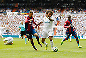 9th September 2017, Santiago Bernabeu, Madrid, Spain; La Liga football, Real Madrid versus Levante; Pedro Lopez  (19) of Levante and Marcelo Viera da Silva (12) of Real Madrid battle for the ball
