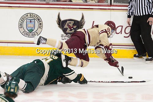 Yvan Pattyn (UVM - 15), Quinn Smith (BC - 27) - The Boston College Eagles defeated the visiting University of Vermont Catamounts 4-2 (EN) in the first game of their best of three Hockey East quarterfinal matchup on Friday, March 15, 2013, at Kelley Rink in Conte Forum in Chestnut Hill, Massachusetts.