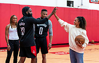 HOUSTON, TX - FEBRUARY 1: James Harden of the Houston Rockets high fives Lynn Williams #13 of the United States at Houston Rockets Training Center on February 1, 2020 in Houston, Texas.