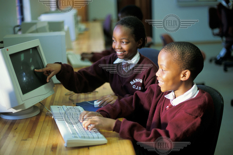 School children using computers at their primary school.