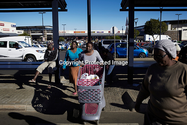 Residents visit the Jabulani shopping mall on May 4, 2013 in Jabulani section, Soweto, South Africa. The mall is one of many new developments in the township helping the people to buy food and goods locally instead of traveling to Johannesburg. Soweto today is a mix of old housing and newly constructed townhouses. The population in Soweto is estimated to be around one million people. (Photo by: Per-Anders Pettersson)