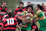 Lea Mohetau gets enveloped by the Papakura defenders. Counties Manukau Premier Club Rugby Game of the Week between Drury & Papakura, played at Drury Domain on Saturday Aprill 11th, 2009..Drury won 35 - 3 after leading 15 - 5 at halftime.