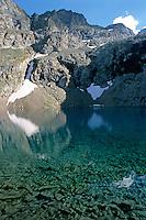 Still Puyvachier Lake near La Meije Glacier, Barre des Écrins, French Alps, France.