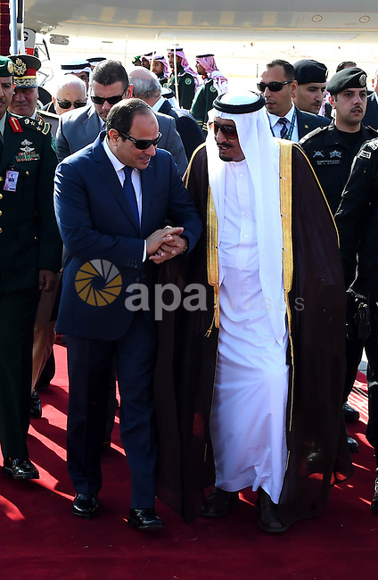 Saudi King Salman bin Abdulaziz welcomes Egyptian President Abdel Fattah al-Sisi at Riyadh international airport on November 10, 2015, as Arab leaders and top officials from South America converged on Saudi Arabia for a summit aiming to strengthen ties between the geographically distant but economically powerful regions.. Photo by Egyptian President Office