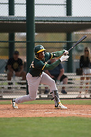 Oakland Athletics left fielder Lazaro Armenteros (13) follows through on his swing during a Minor League Spring Training game against the Chicago Cubs at Sloan Park on March 13, 2018 in Mesa, Arizona. (Zachary Lucy/Four Seam Images)
