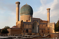 General view of Gur-Emir Mausoleum, 1417-20,Samarkand, Uzbekistan, pictured on July 15, 2010, at dawn. Gur-Emir Mausoleum, or Tomb of the Ruler, was built by Timur in 1404 for his favourite grandson, Mohammed Sultan, and became the mausoleum for the Timurid dynasty. The simply formed building is an octagonal drum beneath an azure fluted dome (diameter: 15m, height: 12.5m). Its walls are tiled in blue and white geometric and epigraphic patterns including the words 'God is Immortal' in 3m. high white Kufic script around the top of the drum. Samarkand, a city on the Silk Road, founded as Afrosiab in the 7th century BC, is a meeting point for the world's cultures. Its most important development was in the Timurid period, 14th to 15th centuries. Picture by Manuel Cohen.