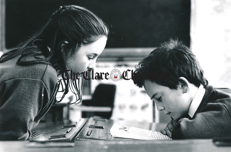 Leanne Lynch and James Fennell pour over a book during sos time at Kilbaha National School - March 5, 1999. Photograph by John Kelly