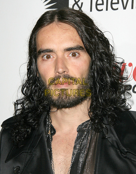 Russell Brand.'Reel Stories, Real Lives' Celebration of the Motion Picture & Television Fund' 90 Years of Service to the Community and Recognizes The Hollywood Reporter's Next Generation Class of 2011 held at Milk Studios in Los Angeles, California, USA..headshot portrait black beard facial hair .CAP/RKE/DVS.©DVS/RockinExposures/Capital Pictures.