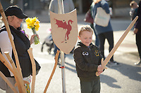 NWA Democrat-Gazette/ANDY SHUPE<br /> Hunter Daniels, 7, smiles Saturday, March 31, 2018, as he picks out a wooden sword for sale with his mother, Stephanie Daniels, as they enjoy the Fayetteville Farmers' Market on the Fayetteville square. The market has returned to the square for the season and is open 7 a.m. to 1 p.m. Tuesdays and Thursdays and 7 a.m. to 2 p.m. on Saturdays.
