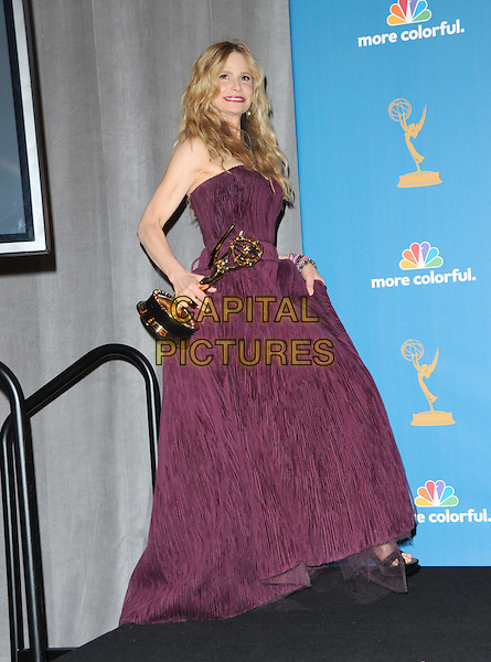 KYRA SEDGWICK.The 62nd Annual Primetime Emmy Awards held at Nokia Theatre L.A. Live in Los Angeles, California, USA. 29th August 2010.full length trophy winner purple strapless gown dress .CAP/RKE/DVS.©DVS/RockinExposures/Capital Pictures.