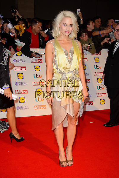 Kimberly Wyatt<br /> The Daily Mirror's Pride of Britain Awards arrivals at the Grosvenor House Hotel, London, England.<br /> 7th October 2013<br /> full length beige yellow dress clutch bag silver <br /> CAP/CJ<br /> &copy;Chris Joseph/Capital Pictures