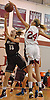 Grace Brady #24 of Glen Cove, right, turns away a shot by Gabrielle Zaffiro #13 of North Shore during a varsity girls' basketball game at Glen Cove High School on Friday, Dec. 18, 2015. Brady recorded 24 points and __ blocks in defeat as North Shore won by a score of 64-53.