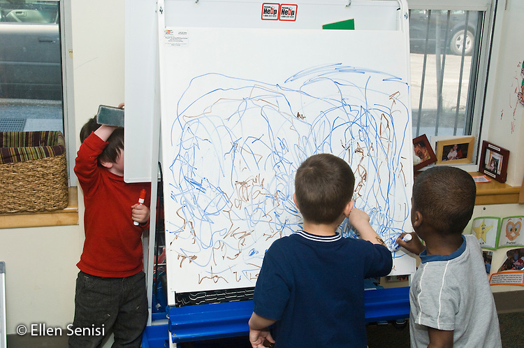 MR / Washington, DC. Hoya Kids Learning Center at Georgetown University (private day care center for toddlers and preschoolers). ID: AI-gPhk. Boys draw together with marker on easel in pre-school classroom. MR: Vau1, Ott1, Tay7. © Ellen B. Senisi