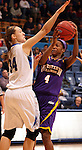 SIOUX FALLS, SD - MARCH 10:  Charnelle Reed #4 from Western Illinois is fouled while shooting by Rebecca Bruner #34 from IPFW in the second half of their quarterfinal game Sunday afternoon at the 2013 Summit League Championships in Sioux Falls, SD.  (Photo by Dave Eggen/Inertia)