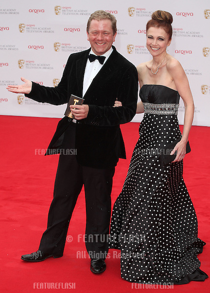 Jon Culshaw and Emma Samms arriving for the TV BAFTA Awards 2013, Royal Festival Hall, London. 12/05/2013 Picture by: Alexandra Glen / Featureflash