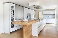 The 'Audran' kitchen by Bulthaup, with a raised breakfast bar and sliding panel to screen kitchen equipment