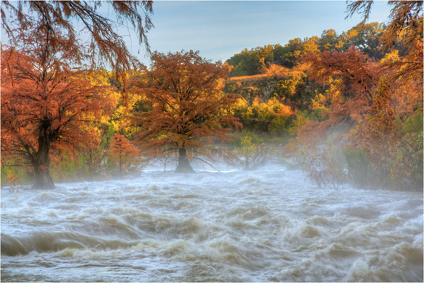 After heavy rains the previous two days, the Pedernales River flowed fast and furious through Pedernales Falls State Park. The cypress, with their leaves in full Autum colors of orange and gold, hung on for dear life. Fog and spray were drifting through the valley as I attemped to capture the power of this usually quiet, peaceful river.