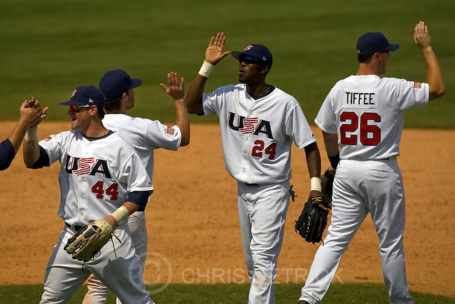 USA's Matt Laporta, #44, Jayson Nix, #3, Dexter Fowler, #24, and Terry Tiffee, #26, celebrate after the game at the Wukesong Baseball Field in Beijing, Friday, August 22, 2008.  USA won the game 8-4, earning the bronze medal. The bronze medal is the second won by the United States in Olympic baseball competition, with the other coming at the 1996 Atlanta Olympic Games. The U.S. won the gold medal at the 2000 Sydney Olympic Games...Chris Detrick/The Salt Lake Tribune.