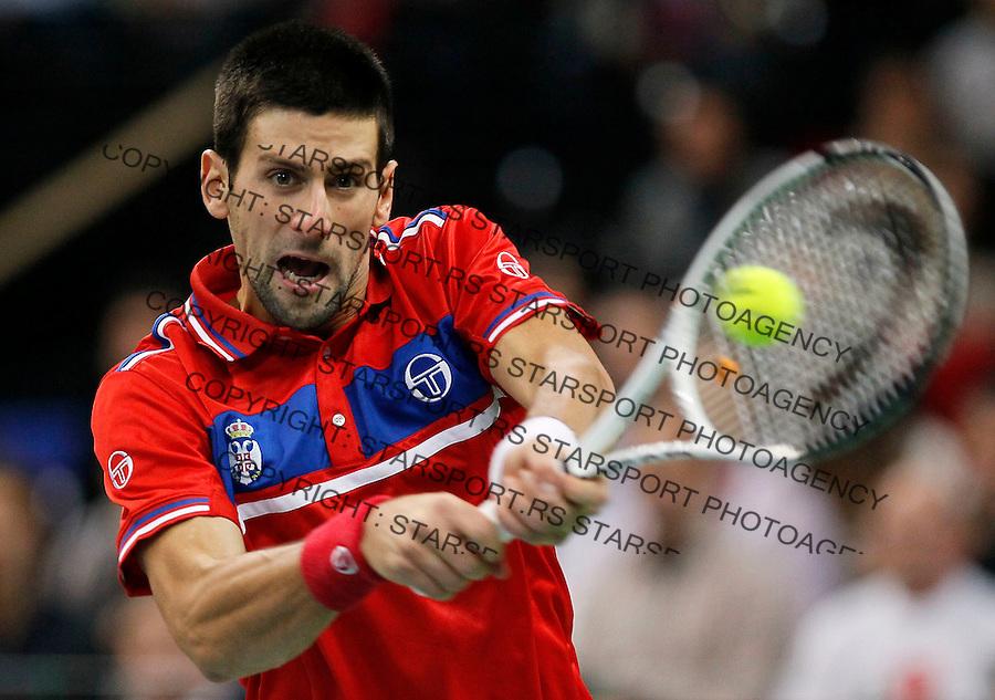 Novak Djokovic of Serbia returns the ball to Gael Monfils of France during their Davis Cup finals tennis match in Belgrade, Serbia, Sunday, Dec. 5, 2010. (credit & photo: Srdjan Stevanovic/Starsportphoto.com)