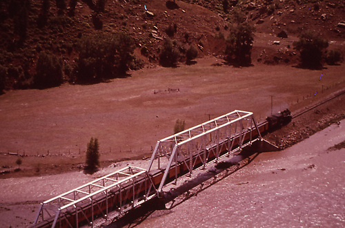 D&amp;RGW train of Silverton cars crossing the double steel truss bridge west of Juanita.  Probably Rocky Mountain Railroad Club excursion of Memorial Day in either 1957 or 1958.<br /> D&amp;RGW  Juanita, CO  1957-1958