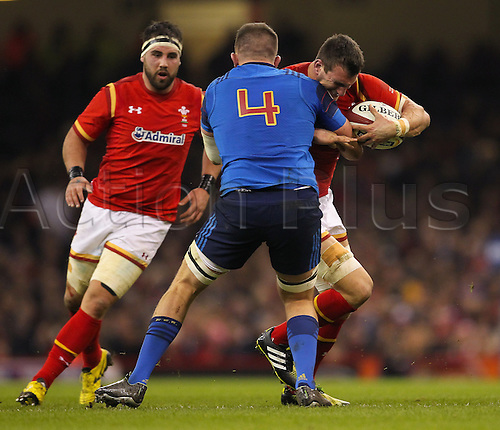 26.02.2016. Principality Stadium, Cardiff, Wales. RBS Six Nations Championships. Wales versus France. Wales Sam Warburton (Capt) gets tackled by France's Paul Jedrasiak